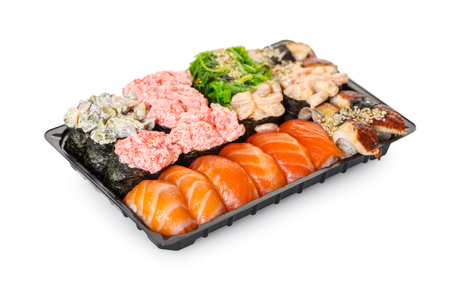 Japanese cuisine, sushi set in a package on a white isolated background