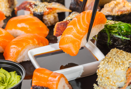 Japanese cuisine, sushi with salmon in soy sauce
