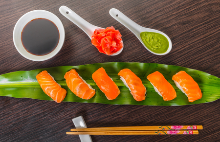 Japanese cuisine, sushi with salmon on a leaf