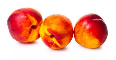 ripe nectarine close-up on white isolated background