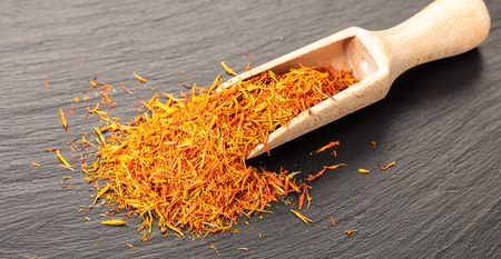 dry spice saffron close-up on a black background