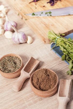 dry spices in a bowl on wooden background