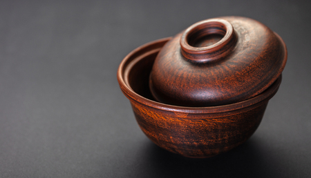 new clay pot closeup on a black background