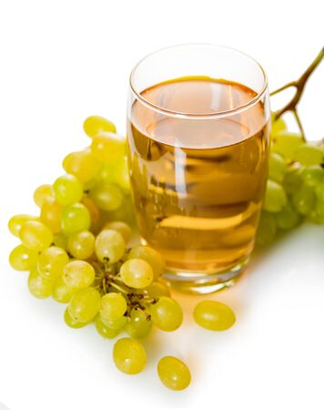 glass of grape juice with bunch of ripe green grapes on a white isolated background