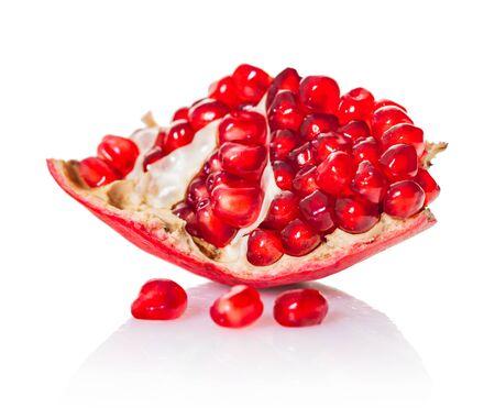 ripe pomegranate fruit close-up on a white isolated background Reklamní fotografie