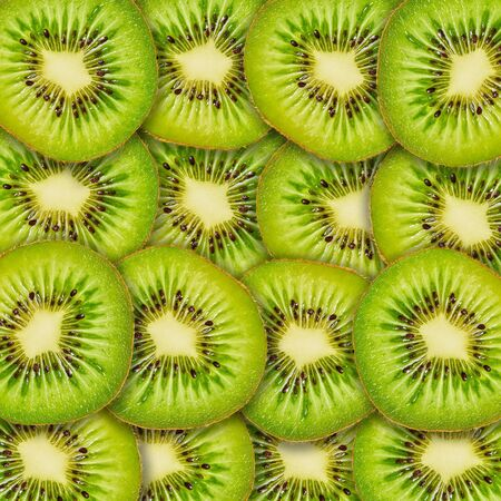 food background, slices of kiwi fruit closeup, focus stacking