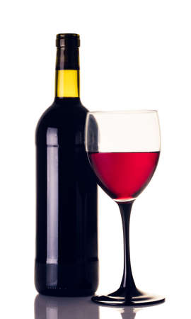 bottle and glass of red wine closeup on white background Stock fotó