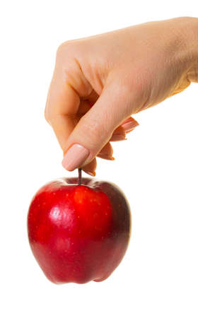 red apple in hand on white isolated background