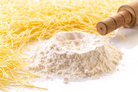 food background, flour and pasta closeup on white Stockfoto