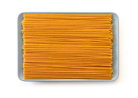 raw pasta top view on white isolated background