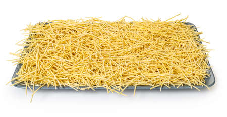 raw pasta noodles on white isolated background with clipping patch