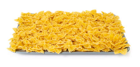 raw pasta farfalle on white isolated background with clipping patch
