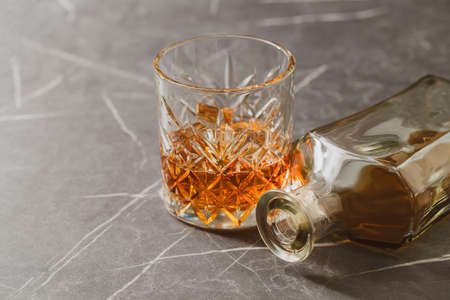alcoholic drink, whiskey on a stone dark background