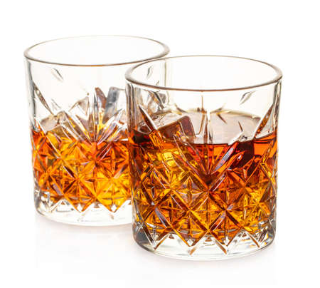 glass of whiskey on white isolated background
