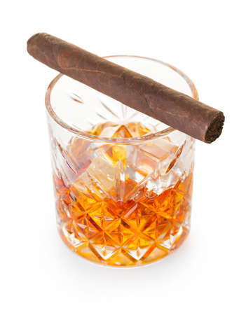 glass of whiskey with cigar on white isolated background 免版税图像