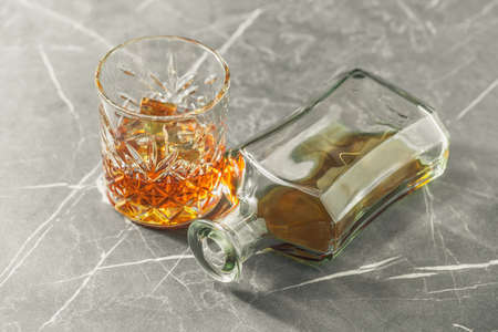 alcoholic drink, whiskey on a stone dark background