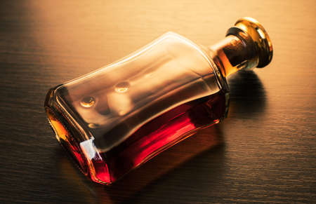 alcoholic drink, bottle of whiskey on wooden background