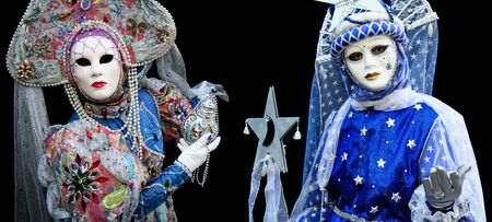 A man and a woman with a mask during Carnival in Venice photo