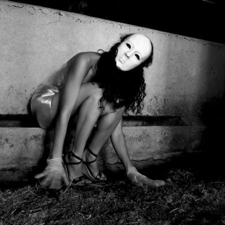 Masked dancer wrapped in cellophane transparent