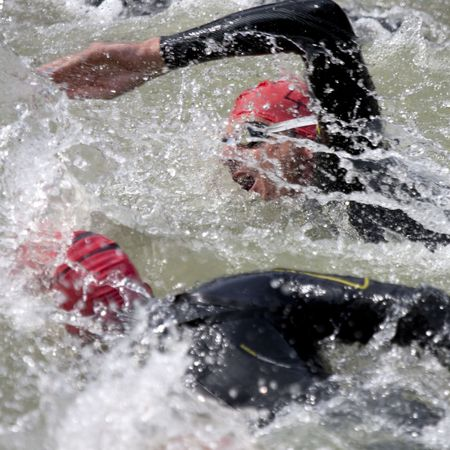 swim race: two swimmers at the start of a triathlon Stock Photo