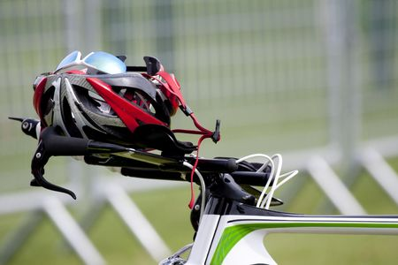 Helmet on the handlebars of a bike in triathlon transition zone