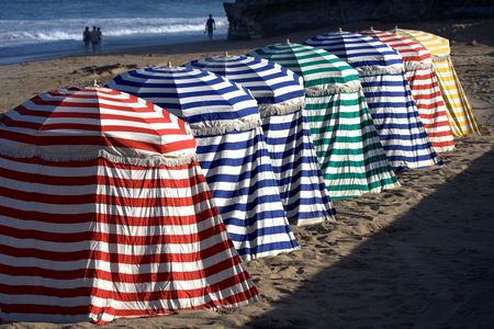 colorful array of tents on the beach in Biarritz, Basque Country, France