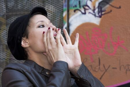 toulouse: A young woman shouted, her hands to her mouth Stock Photo