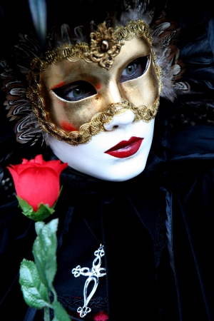 mystery woman: Masked lady with a rose during the Venice carnival, portrait, Stock Photo