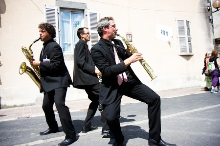 Aurillac International Street Theatre Festival in France, 2010. Three musicians in the street. Editorial