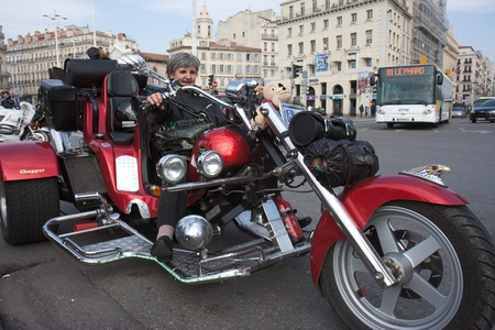 Marseille, France: March 6th, 2011. Motorcycle rally for the Womens Day in the Vieux-Port, Marseille,FR. A senior rides a chopper.