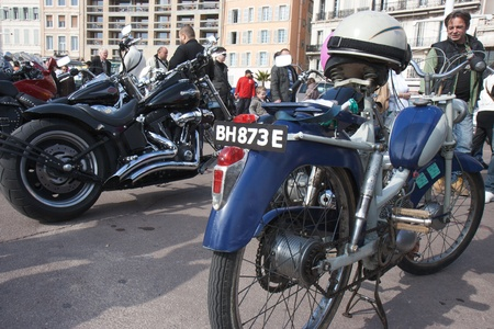 Marseille, France: March 6th, 2011. Motorcycle rally for the Womens Day in the Vieux-Port, Marseille,FR. A retro bike.