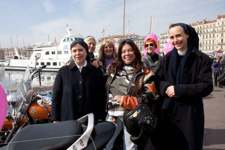 nuns: Marseille, France: March 6th, 2011. Motorcycle rally for the Womens Day in the Vieux-Port, Marseille,FR. Bikers with nuns. Editorial