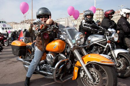 Marseille, France: March 6th, 2011. Motorcycle rally for the Womens Day in the Vieux-Port, Marseille,FR. A biker with raised thumb.