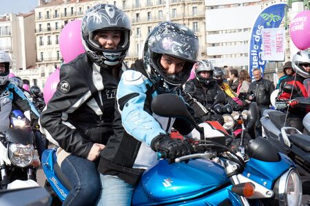 Marseille, France: March 6th, 2011. Motorcycle rally for the Womens Day in the Vieux-Port, Marseille,FR. Two nice bikers.