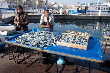 MARSEILLE, FRANCE, MARCH 6: fishmongers on the open-air market of the Vieux-port, on Sunday, March 6th, 2011, in Marseille, France