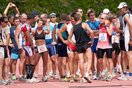 AUCH, FRANCE,  SEPTEMBER 4, 2010: Auch triathlon, competitors waiting for the running , on September 4th, 2010, in Auch, France.