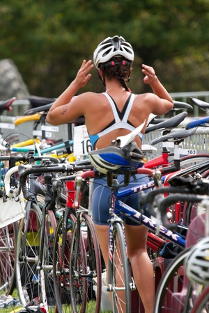 AUCH, FRANCE,  SEPTEMBER 4, 2010: Auch triathlon, female competitor in the transition area after the swim race and before the cycle race, on September 4th, 2010, in Auch, France. Sajtókép
