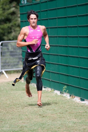 AUCH, FRANCE,  SEPTEMBER 4, 2010: Auch triathlon, male runner in the transition area after the swim race, on September 4th, 2010, in Auch, France.