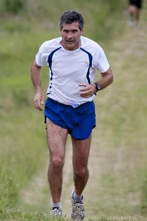 PAVIE, FRANCE - MAY 22, 2011: Senior runner at the Trail of Pavie, on May 22, 2011, in Pavie, France.