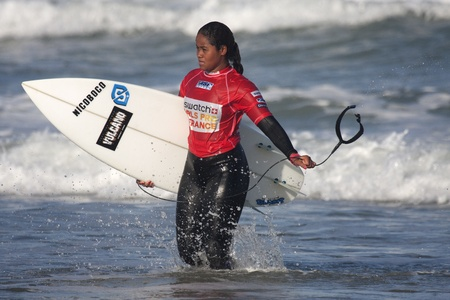 SEIGNOSSE, FRANCE - JUNE 3, 2011:  surfer Swelen Naraisa at the end of her contest at the Swatch Pro France on June 3, 2011, in Seignosse , France. Editorial