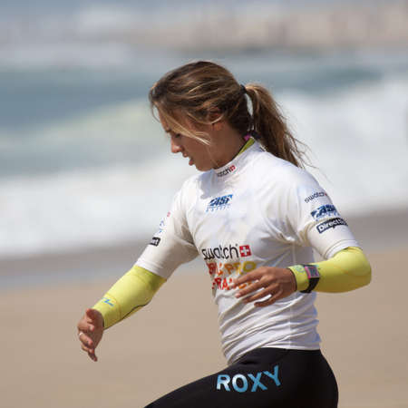 SEIGNOSSE, FRANCE - JUNE 3, 2011: surfer Sally Fitzgibbons on the beach before her contest at the Swatch Pro France on June 3, 2011, in Seignosse , France.