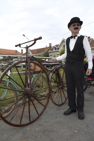 SOULAC SUR MER, FRANCE - JUNE 5, 2011: Biker with an old bicycle at the Soulac 1900 festival on june 5, in Soulac sur mer, France. Every year all the resort relives his Belle Epoque 1900 .