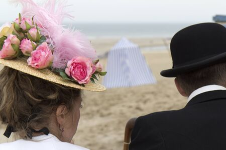 SOULAC SUR MER, FRANCE - JUNE 5: couple wearing vintage hats at the Soulac 1900 festival june 5, 2011, in Soulac sur mer, France. Every year all the resort relives his Belle Epoque . Stock Photo - 9730235