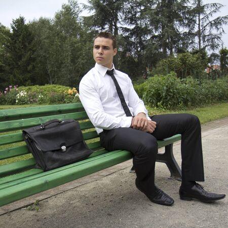 Businessman sitting on a bench. photo