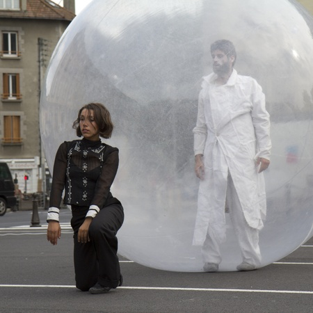 AURILLAC, FRANCE- AUGUST 18: Aurillac International Street Theater Festival, Cie  Jimyprod,a woman is dancing and a man is walking in a transparent ball, on August 18, 2011 in Aurillac, France.  Editorial