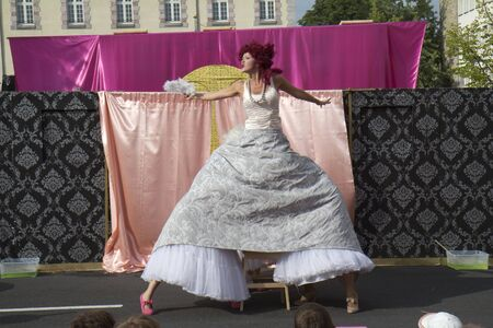 underskirt: AURILLAC, FRANCE- AUGUST 18:  Unidentified actress plays in the street  as part of the Aurillac International Street Theater Festival, Cie  Murmurs on August 18, 2011 in Aurillac, France.