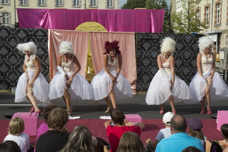 AURILLAC, FRANCE- AUGUST 18:  Unidentified actresses play in the street  as part of the Aurillac International Street Theater Festival, Cie  Murmurs on August 18, 2011 in Aurillac, France.  Editorial
