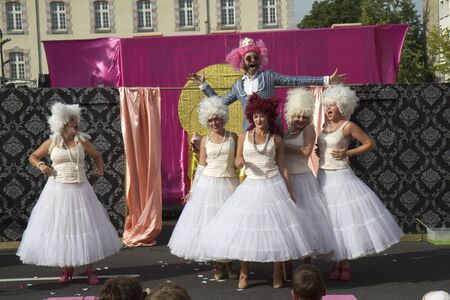 AURILLAC, FRANCE- AUGUST 18:  Unidentified actors play in the street  as part of the Aurillac International Street Theater Festival, Cie  Murmurs on August 18, 2011 in Aurillac, France.