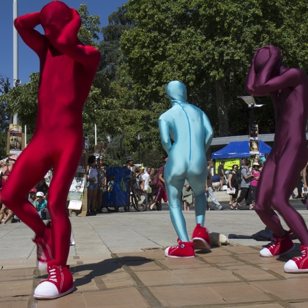 AURILLAC, FRANCE- AUGUST 17:  Three unidentified dancers move in the street as part of the Aurillac International Street Theater Festival, Cie V.O on August 17, 2011 in Aurillac, France.