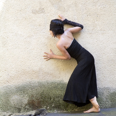doppelganger: AURILLAC, FRANCE- AUGUST 17: Barbara Murata dances as part of the Aurillac International Street Theater Festival,  show Doppelganger, on August 17, 2011 in Aurillac, France.